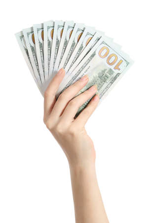 Hand holding money one hundred dollars banknotes isolated on a white background photo