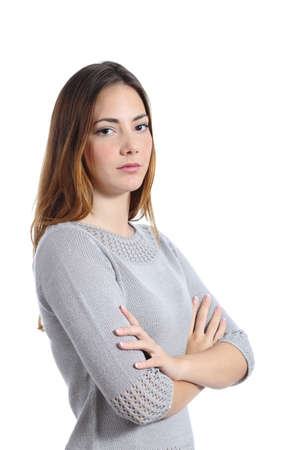 neutral face: Portrait of an angry serious woman with folded arms isolated on a white background Stock Photo