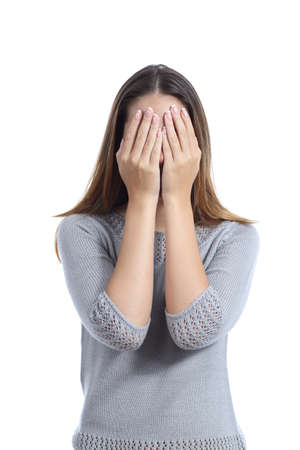 Woman covering her face with both hands isolated on a white background Stockfoto