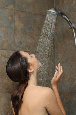 naked young women: Woman enjoying the water in the shower under a water jet