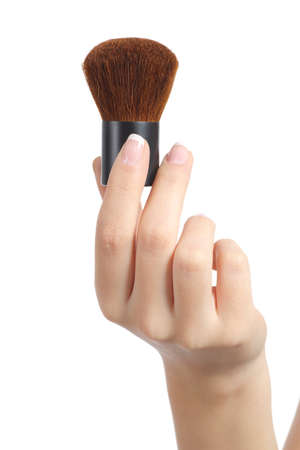 Woman hand holding a makeup brush isolated on a white background photo