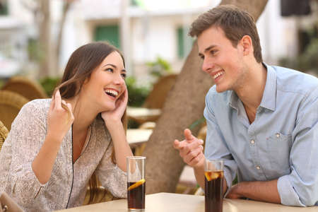 dating: Couple dating and flirting while taking a conversation and looking each other in a restaurant