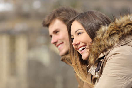 man profile: Happy couple profile looking forward in winter holiday Stock Photo