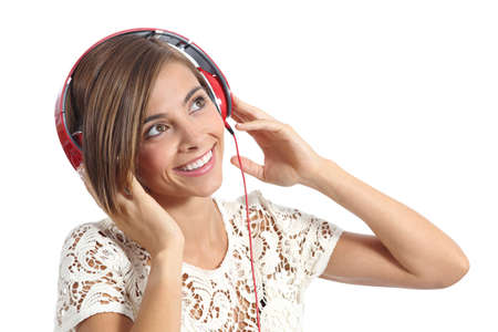 Happy girl enjoying and  listening to the music with headphones isolated on a white background photo