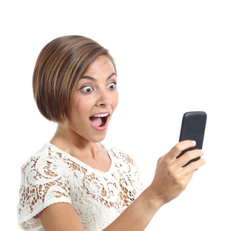 Happy woman surprised looking her smart phone isolated on a white background Stock Photo