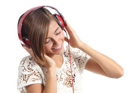 Candid happy woman feeling the music from red headphones isolated on a white background photo