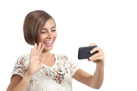 Girl waving on the smart phone while during a video call isolated on a white background photo