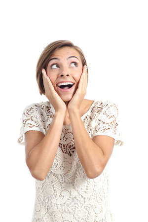 Happy shocked woman looking at side with hands on face isolated on a white background