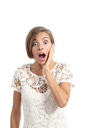 Great: Shocked or surprised woman with a hand on face expressing wow isolated on a white background