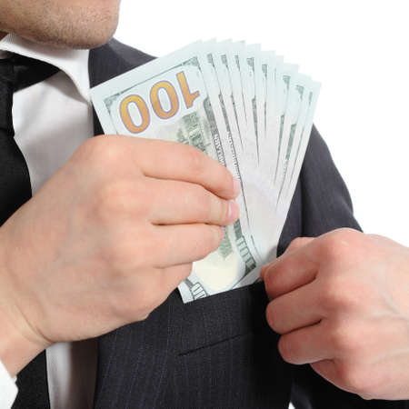 corruptible: Close up of a business man hand keeping money in his pocket isolated on a white background Stock Photo