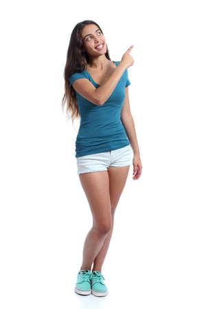 흰색 배경에 고립 된 측면에서 가리키는 제시하는 십 대 발기인 소녀