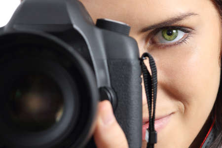 photo camera: Close up of front view of a photographer woman eye photographing with a dslr camera Stock Photo
