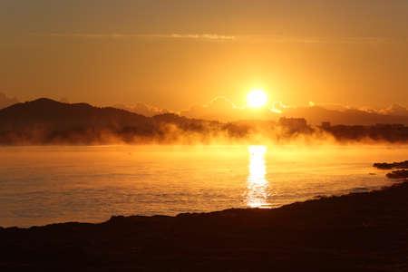 Winter sunrise landscape in the beach of Majorca photo
