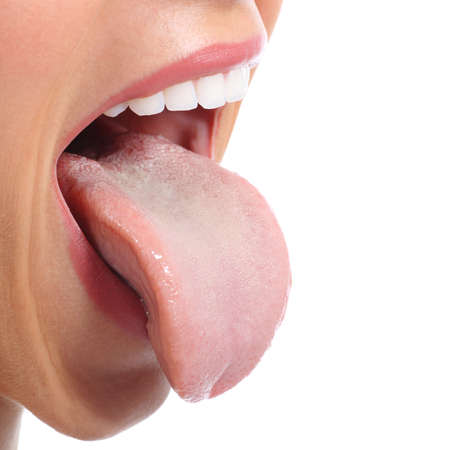mouth  open: Close up of a woman mouth sticking tongue isolated on a white background