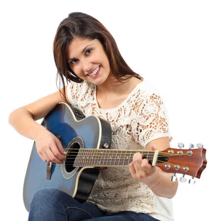 Musician woman playing guitar in a course isolated on a white background Stock Photo