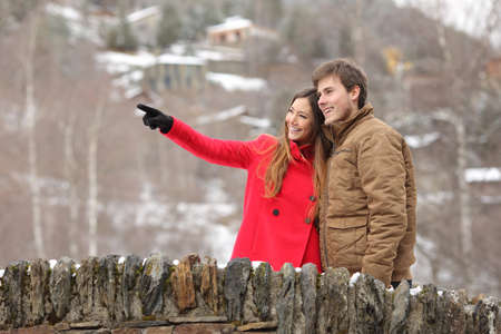 happy holidays: Happy couple of tourists crossing a bridge in winter holidays Stock Photo