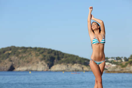 Beauty woman posing and showing her laser hair removal legs and armpit