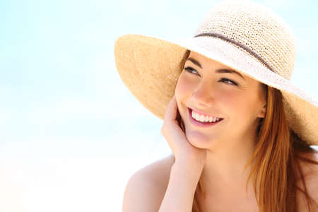 Beauty woman with white teeth smile looking sideways
