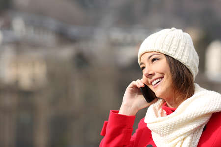 warmly: Girl talking on the mobile phone warmly clothed in winter Stock Photo