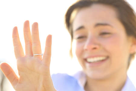 proposing: Happy woman looking an engagement ring after proposal in a sunny day Stock Photo