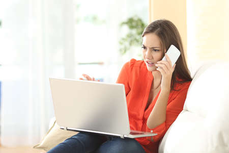 stressed business woman: Angry woman calling to customer service with a laptop failure Stock Photo