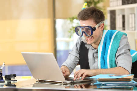 Businessman working on line or searching travel destinations with goggles needing vacations at office 写真素材