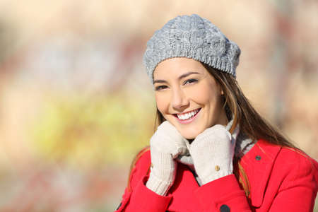 warmly: Beauty woman with perfect white smile posing warmly clothed in a sunny day of winter