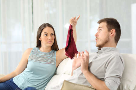annoyed: Wife finds panties on a sofa and discovers that her husband is cheating