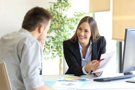 woman boss: Boss showing a good job congratulating an employee at office Stock Photo