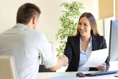 handshaking: Successful job interview with boss and employee handshaking
