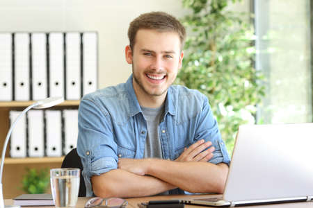 Proud freelance man posing at office and looking at camera Stock Photo