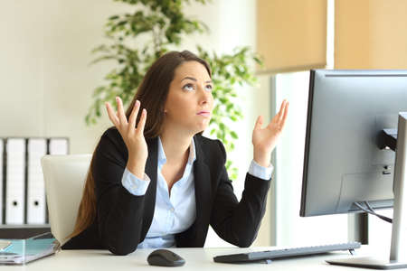 difficult to find: Worried businesswoman working online and praying looking above at office