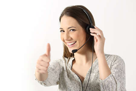 Portrait of a phone operator looking at you and gesturing thumbs up on a white background Archivio Fotografico