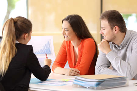 Happy businesspeople talking about earnings during an audit at office Banco de Imagens - 81952561