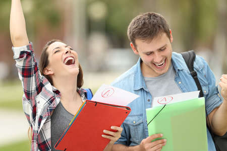 Two excited students with approved exams in the street