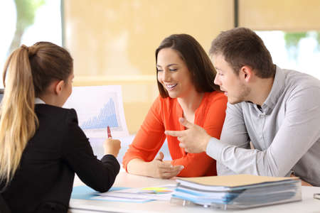 Three partners checking and commenting a growth graph at office