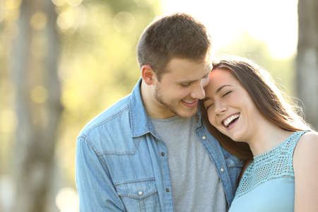 Affectionate couple in love laughing in a park Stok Fotoğraf