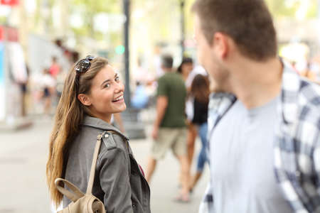 Casual girl in love meeting her crush on the street Фото со стока