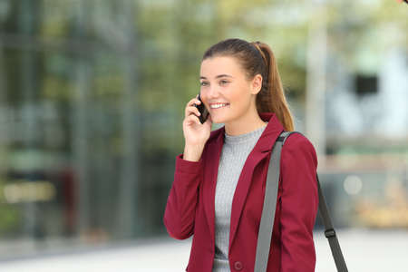 Single young businesswoman calling on phone on the street Stock Photo