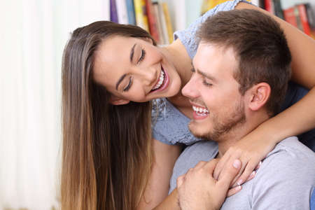Happy couple in love flirting looking each other at home Reklamní fotografie