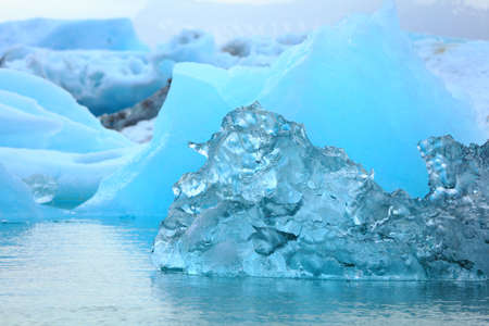 Detail of a little blue iceberg floating on the sea Stock Photo