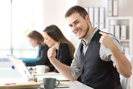 Portrait of a proud businessman pointing himself at office Standard-Bild
