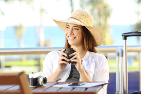 Single happy tourist relaxing during a vacations travel in the balcony of the hotel room or apartment
