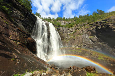 Beautiful waterfall and rainbow landscape in Norway mountains Reklamní fotografie