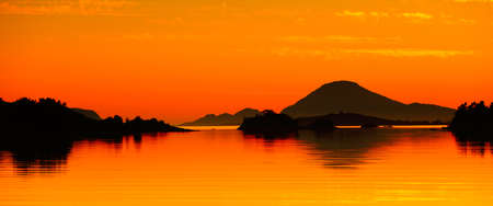 Panoramic view of a beautiful orange seascape at sunset in Norway Reklamní fotografie