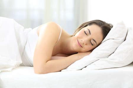 Portrait of a satisfied woman sleeping in a comfortable bed 版權商用圖片