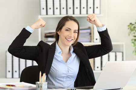 Motivated strong and confident businesswoman looking at camera at office Фото со стока
