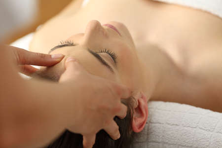 Closeup of a woman receiving a relaxing facial massage in a spa Reklamní fotografie