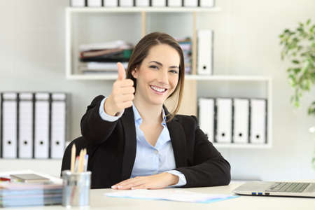 Proud office worker posing with thumbs up looking at camera Stok Fotoğraf