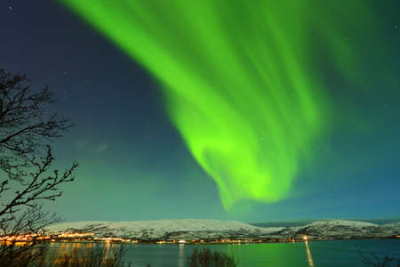 Beautiful green northen lights from Tromso in Norway sky Stok Fotoğraf